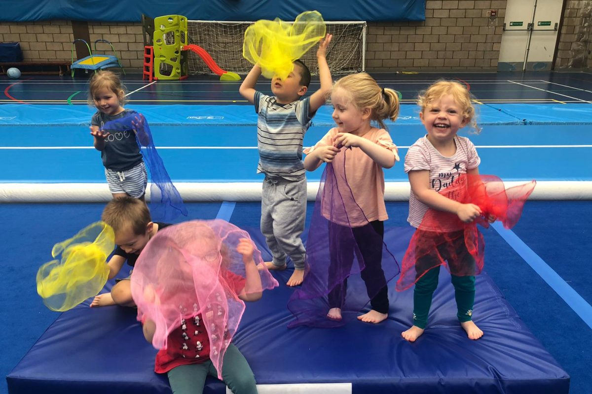 Kids playing during a gymnastics activity party hosted by SSG