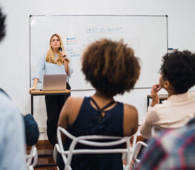 business-woman-explaining-plan-of-work-in-conferen-N7LJNE9
